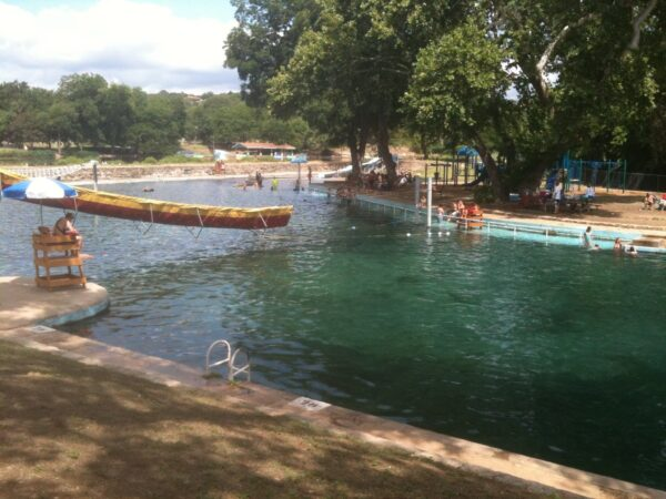 An excursion on a paddle boat is one of the best ways to see the Comal Springs and Landa Lake.