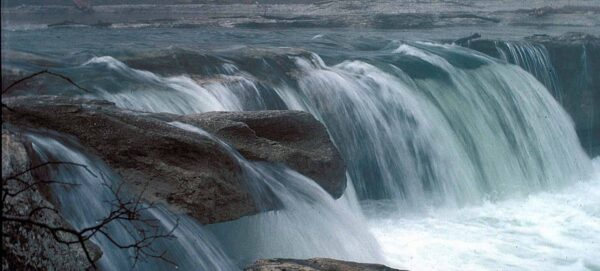 Falls cascade through limestone formations into peaceful pools in McKinney Falls State Park.