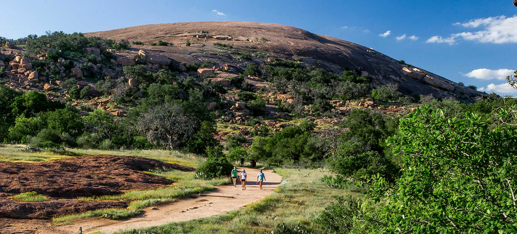 Enchanted Rock is a beautiful pink granite dome perfect for exploring and enjoying nature.